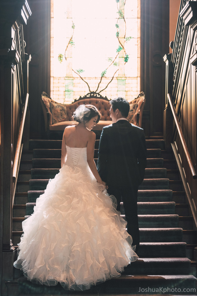 Bride and Groom on grand stair at Alexander Mansion Dallas