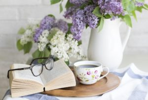 book glasses tea flowers
