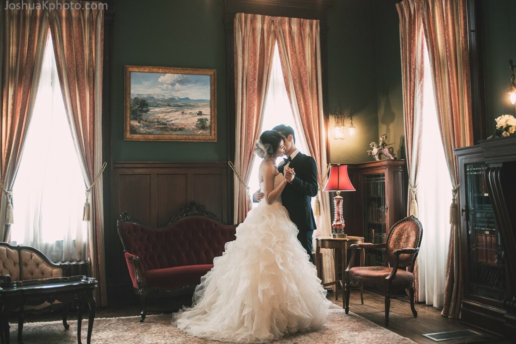 Bride and groom in library at the Alexander Mansion, Dallas, Texas