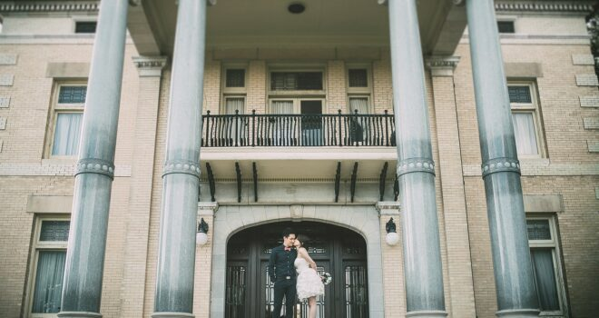 Engaged couple on steps of Alexander Mansion, Dallas, Texas